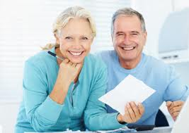 Husband and wife with home inventory on paper