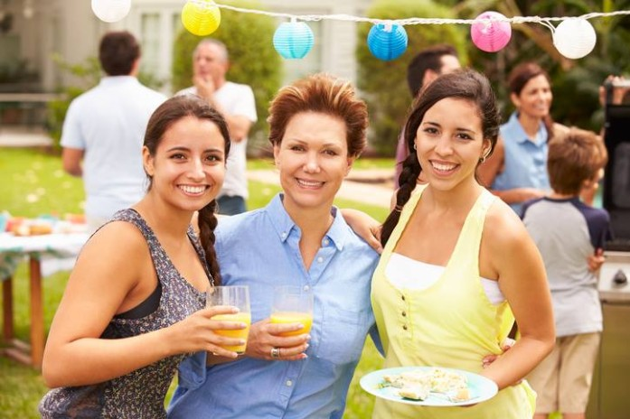 Women at an outdoor party celebrating