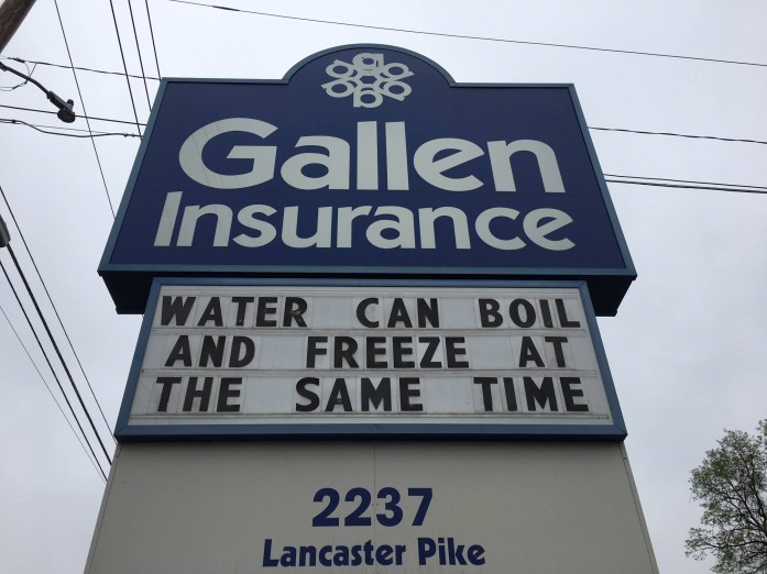 Gallen Insurance sign says water can boil and freeze at the same time